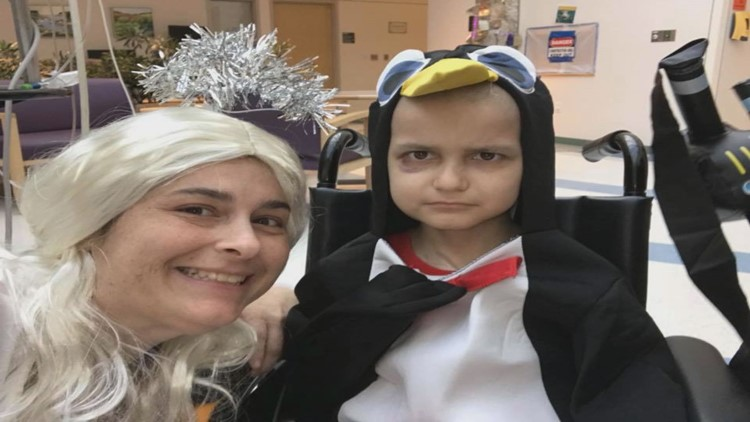 9 year old Jacob dressed up like a penguin on Halloween 2017