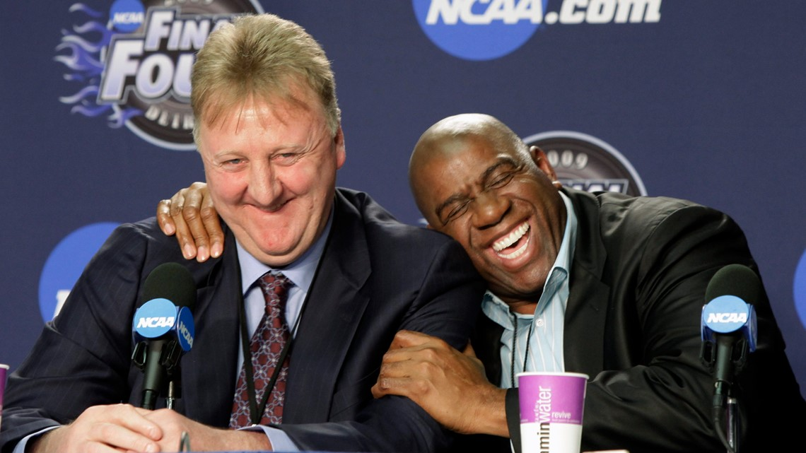 After fighting over so many trophies, Larry and Magic now have one to share