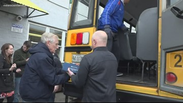 Sen. Angus King, volunteers unload donations for annual 'Stuff the Bus' food drive