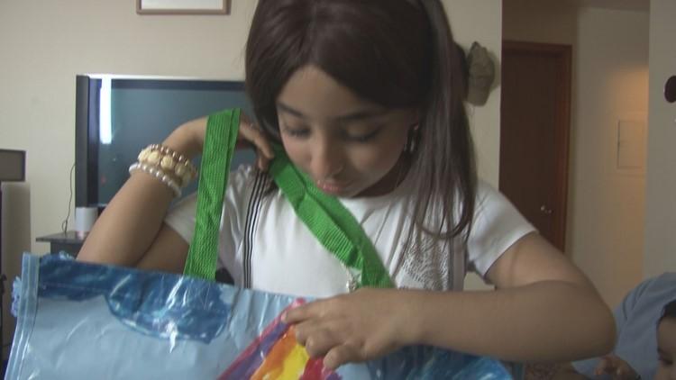 Sarah Aeedy with the HomeGoods reusable bag she designed.