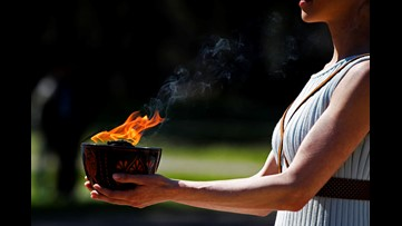 Olympic flame still burns despite calls to cancel games over coronavirus