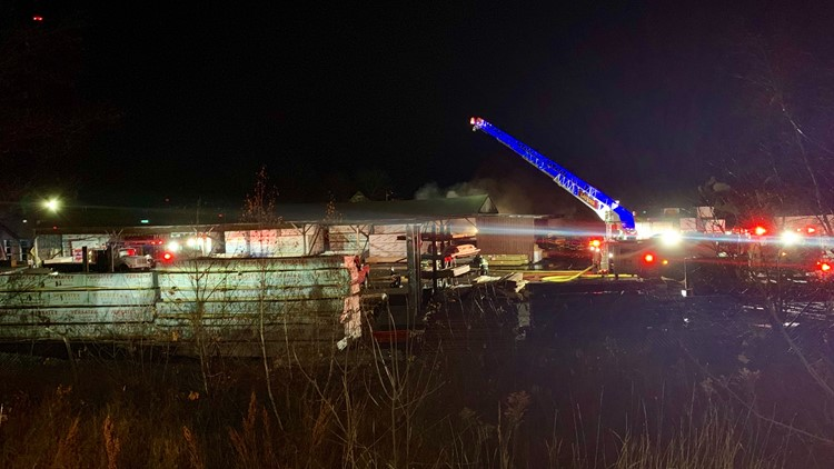 Overnight fire rips through lumber yard, closes roads