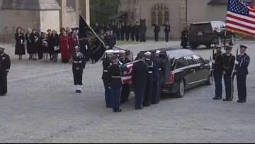 Cristina Lewis from Auburn held the presidential flag at George H. W. Bush's funeral