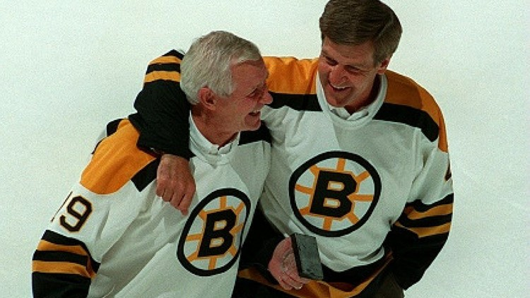 Former Boston Bruins Johnny McKenzie (left) and Bobby Orr take one last skate together at the final event held at the Boston Garden in Boston before its closure on Sept. 26, 1995