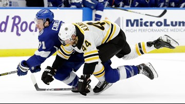 Lightning strike down Bruins in pursuit of single-season win record