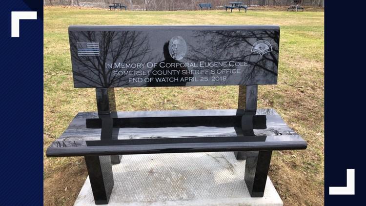 Town installs memorial bench, overlooks bridge named after fallen officer