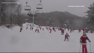 Hundreds of Santas ski Sunday River for charity