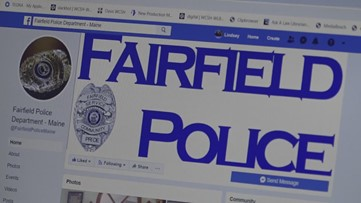 Fairfield police officers distribute laptops