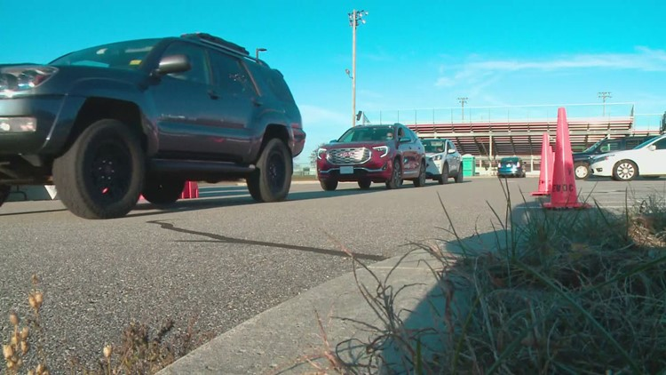 Cars line up in South Portland for the drive-thru flu clinic
