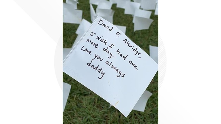 Loved ones personalize 660,000 white flags planted on National Mall in honor of those who have died of COVID-19