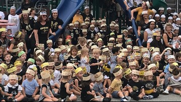 Students make 'Child of God' headbands to support Saints' Demario Davis