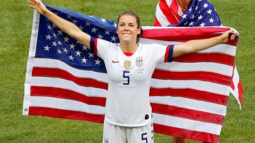 Fayetteville's Kelley O'Hara wins over the internet with US flag rescue, post-game kiss, locker room celebration