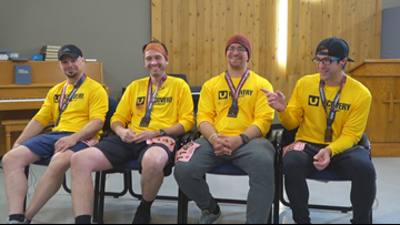 Group of men recovering from substance abuse finish marathon